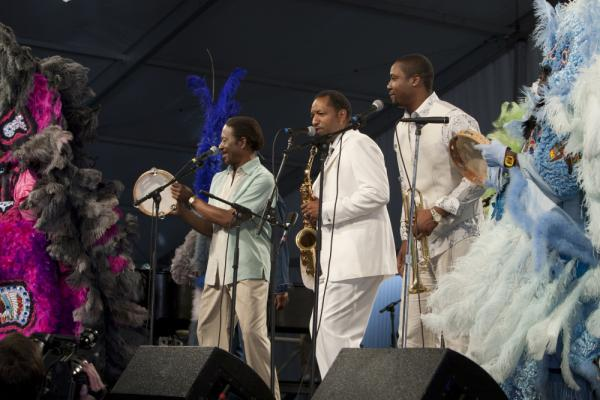 Albert Lambreaux (Clarke Peters), Donald Harrison and Delmond Lambreaux (Rob Brown) perform with Mardi Gras Indians at the New Orleans Jazz and Heritage Festival, on <em>Treme</em>.