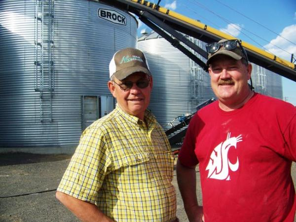 Dana Herron and his partner Craig Teel, of Tri State Seed Company in Connell, Wash. The co-owners say this year is treating Northwest wheat farmers pretty fair with higher prices. Photo by Anna King