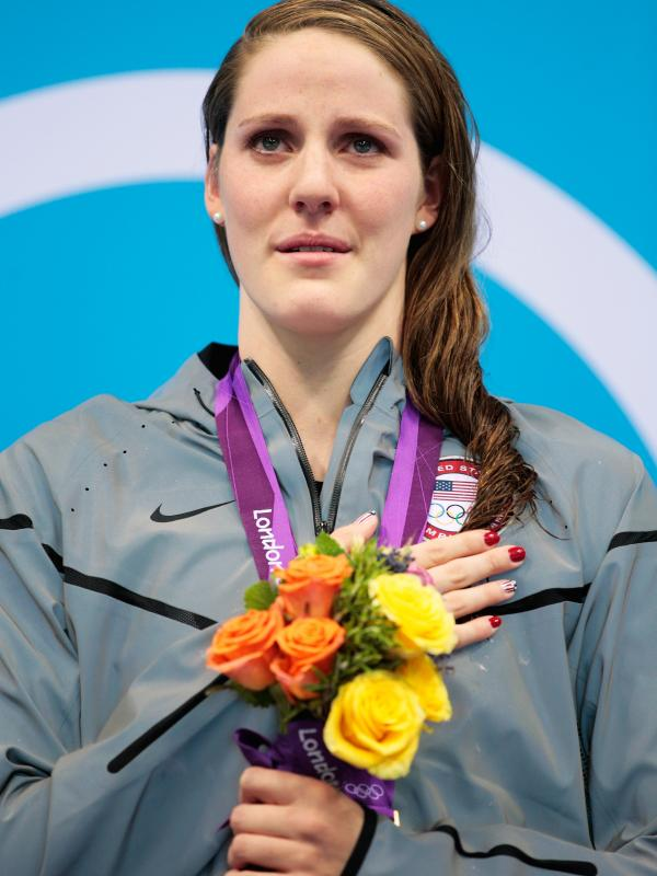 "Missy Franklin stands on the podium with her gold medal, after winning the 100m backstroke at the London 2012 Olympic Games. Of that moment, she says, ""I was trying to sing, but I was like, crying, at the same time."""