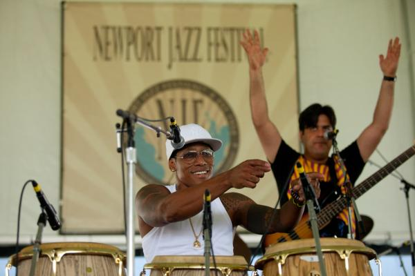 '8/4/12 Newport, RI. — Pedrito Martinez Group performs on the Quad Stage at the Newport Jazz Festival August 4, 2012.  Photo by Erik Jacobs for NPR.'