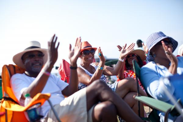 '8/4/12 Newport, RI. — Concert goers, including Corliss Wise of Columbia SC (Center), listen to music outside the Fort Stage at Fort Adams State Park at the Newport Jazz Festival August 4, 2012.  Photo by Erik Jacobs for NPR.'