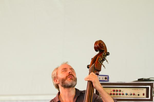 '8/4/12 Newport, RI. — The Bad Plus with Bill Frisell play on the Quad Stage at the Newport Jazz Festival August 4, 2012.  Photo by Erik Jacobs for NPR.'