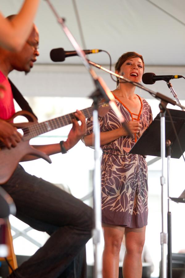 Gretchen Parlato (right) and Lionel Loueke met in a prestigious graduate jazz program and have been performing together ever since. They've previously led their own bands at Newport, but on Sunday at the Harbor Stage, they were offered a more intimate billing.