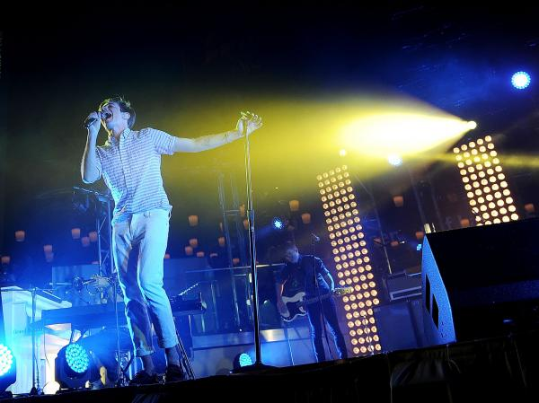 Singer Nate Ruess of fun. performs in Las Vegas. Behind Ruess are lighting director Jackie Finney's favorite new tools: towers of white lights called kryptons.