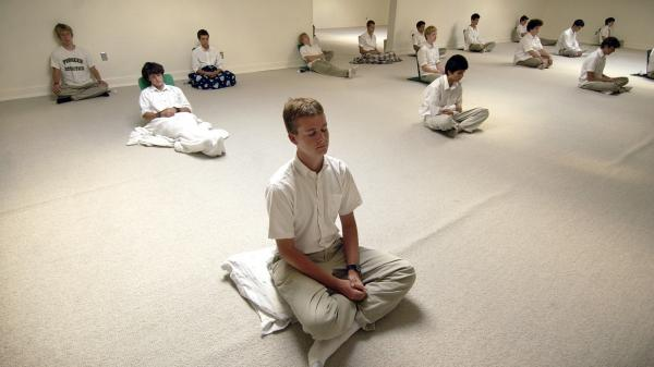 Maharishi School of the Age of Enlightenment students do their daily practice of Transcendental Meditation in Fairfield, Iowa, in September 2004.