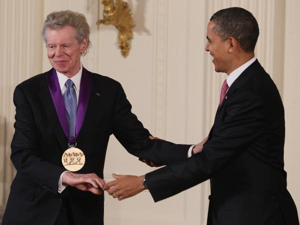 President Obama congratulates pianist Van Cliburn after presenting him with the National Medal of Arts in 2011.