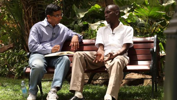Commentator and writer Dinesh D'Souza, who directed the documentary <em>2016: Obama's America</em>, interviews George Obama, the president's half-brother.