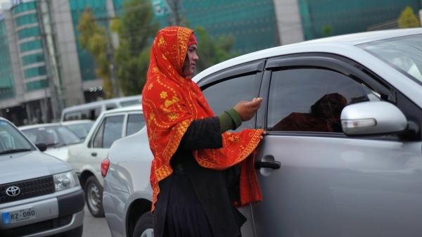A transgender woman begs for alms from motorists at a traffic stop in Rawalpindi, outside Islamabad, Pakistan, on March 27.