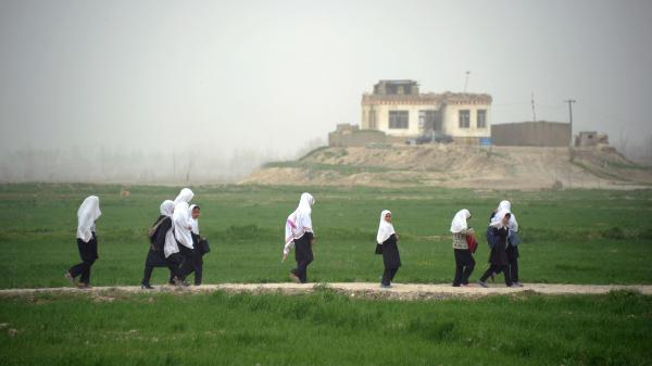 Afghan girls walk home from school in Kunduz province earlier this year. Despite progress in recent years, girls who want an education face threats from the Taliban and other extremists, and sometimes even their own families.