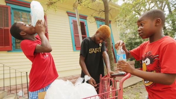 Kids in New Orleans on Monday getting some relief from the heat thanks to ice being distributed to those without power.