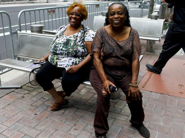 Creola Boswell (left) and her sister Susie Collins flew to Charlotte from California to enjoy the convention atmosphere.