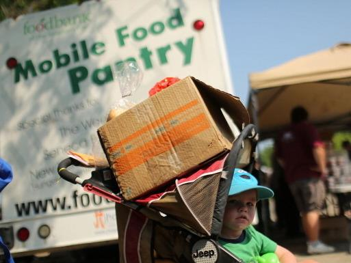 In Oswego, N.Y., this summer, a child waited at a food distribution site.