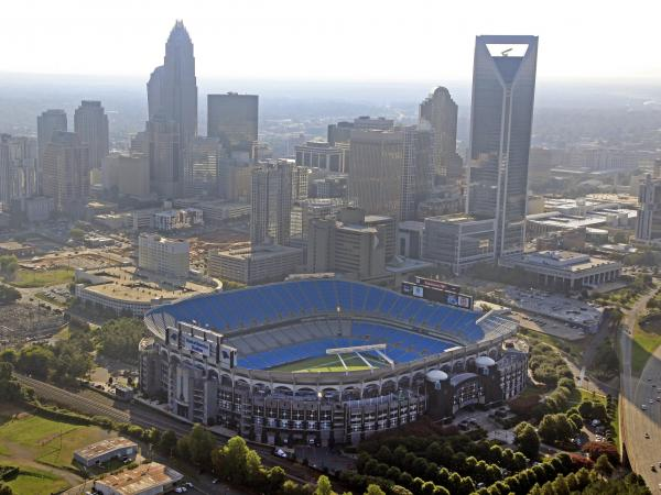 The skyline of Charlotte, N.C., rises behind Bank of America Stadium.