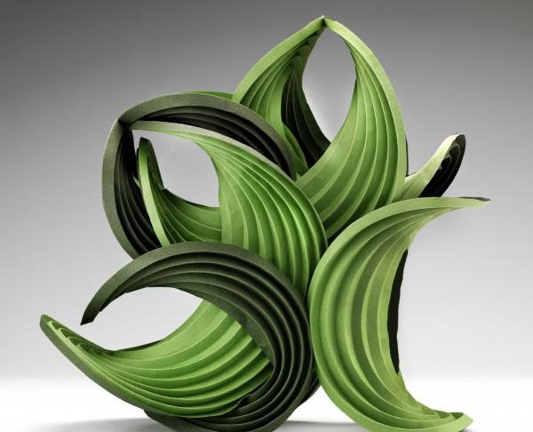 "<em>Green Balance </em>is a 2011 work by <a href=""http://40u40.beancreative.com/artist08.html"">Erik Demaine</a> and his father, Martin Demaine. As a scientist, Erik Demaine says he works to ""explore curved creased folding from both a mathematical and an artistic perspective."""