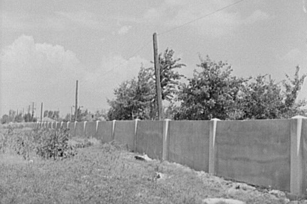 The concrete wall separating the black and white sections of Detroit is seen in 1941.