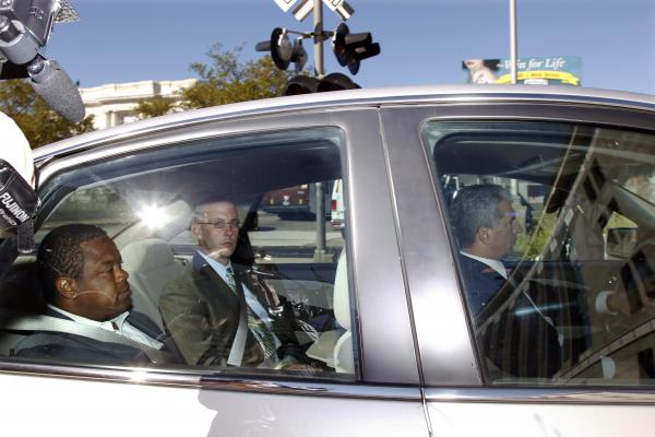 Trenton Mayor Tony Mack, left, is driven in custody into the federal courthouse in Trenton, N.J. on Monday.