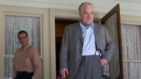 Navy veteran Freddie (Joaquin Phoenix) falls under the influence of cult leader Lancaster Dodd (Philip Seymour Hoffman) in <em>The Master</em>.