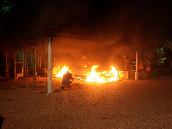 A vehicle and the surrounding area are engulfed in flames after it was set on fire inside the U.S. consulate compound in Benghazi late on September 11, 2012. An armed mob protesting over a film they said offended Islam, attacked the U.S. consulate in Benghazi and set fire to the building.