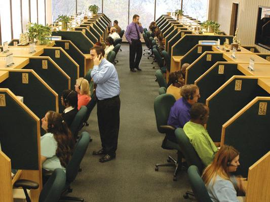 Telemarketers at work at an InfoCision call center. The for-profit company solicits millions in charitable donations each year and also provides marketing services to for-profit clients.