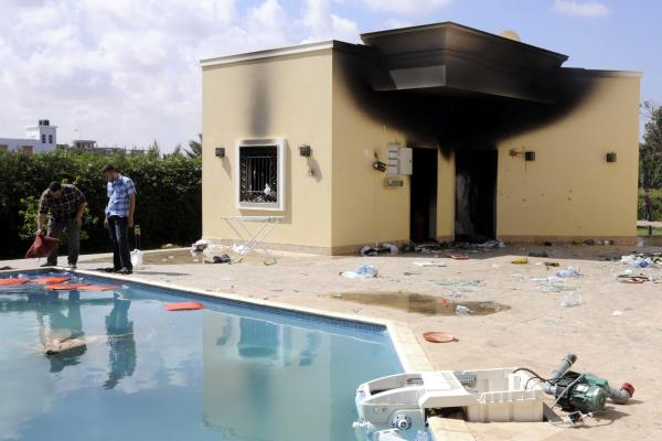 People inspect the damage at the U.S. consulate, one day after armed men stormed in during a protest over a film they said offended Islam, in Benghazi.