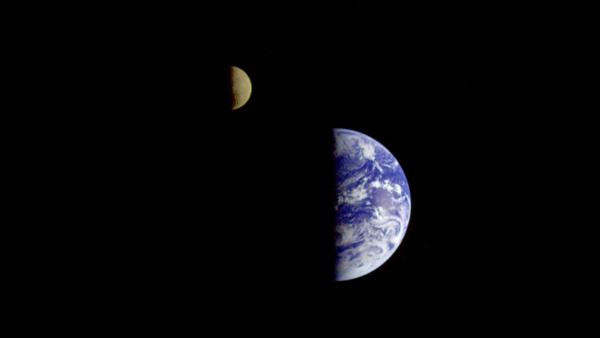 On its way to Jupiter, the Galileo spacecraft looked back and captured this remarkable view of Earth and the moon. The image was taken from a distance of about 3.9 million miles.