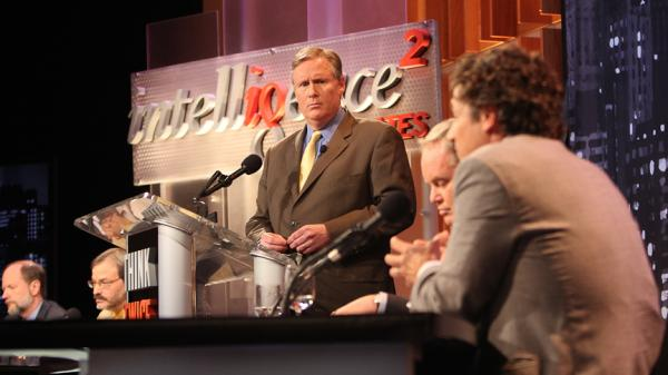 John Donvan of ABC News moderates an <em>Intelligence Squared</em> debate on the regulation of money in politics.