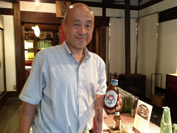 Kiuchi Brewery vice president Youichi Kiuchi holds a bottle of his company's Hitachino Nest beer.