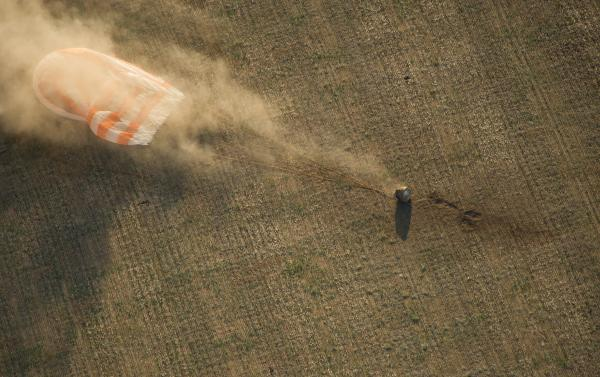 The Soyuz TMA-04M capsule lands in a remote area near the town of Arkalyk, Kazakhstan, Monday. Padalka, Acaba and Revin returned from five months onboard the International Space Station, where they served as members of the Expedition 31 and 32 crews.