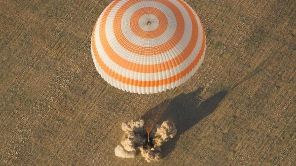 The Soyuz capsule lands with Commander Gennady Padalka of Russia, NASA Flight Engineer Joe Acaba and Russian Flight Engineer Sergei Revin aboard, near the town of Arkalyk, Kazakhstan. The capsule's final meter of descent is eased by braking engines.