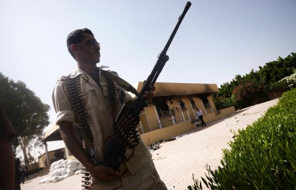 A member of the Libyan security forces secures the area around the U.S. Consulate compound in Benghazi on Sept. 14. Benghazi, and other parts of eastern Libya, are suffering from an acute lack of security, making it vulnerable to militant violence.