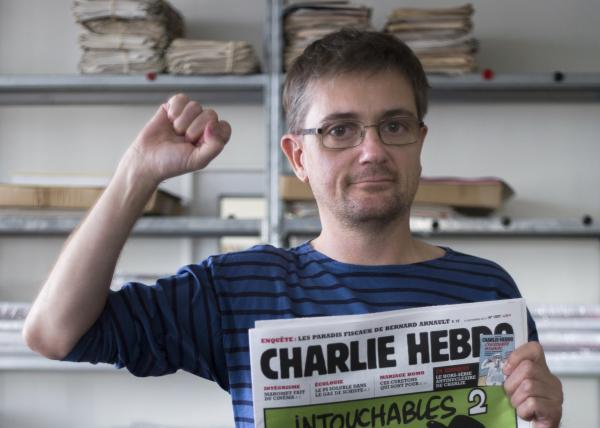"At the offices of the French satirical weekly<em> Charlie Hebdo</em> earlier today, publisher/editor Stephane Charbonnier (""Charb"") struck a defiant pose."
