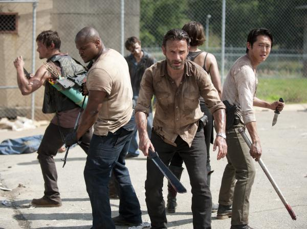 A group of humans struggles to survive a zombie apocalypse in AMC's <em>The Walking Dead</em>.