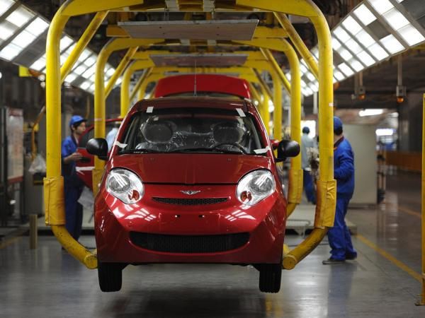 Workers assemble one of the many car models at Chinese carmaker's Chery Automobile plant in Wuhu, east China's Anhui province.