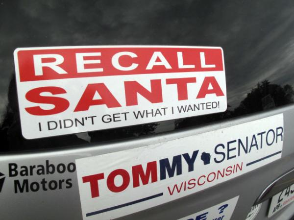 "A bumper sticker on the car of Bob Greenwood of Baraboo, Wis. ""Recall Santa"" reflects the bitterly divisive recall election this year, which Republican Gov. Scott Walker survived easily."