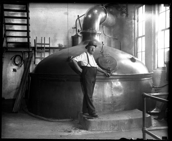 Conrad Griesser, brewmaster for Reisch Brewery in Springfield, stands in front of a brew kettle with a 360-barrel capacity. After the repeal of Prohibition in 1933, the Reisch family raised $250,000 to refurbish the plant with new equipment. The <em>State Journal</em> published a package of pictures on July 8, 1934 just as they were reopening. The brewery closed in 1966.