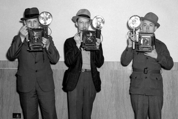 Raymond Hodde (left) was hired in 1930 and was the <em>State Journal's</em> first full-time staff photographer. He was joined later in the decade by Joe Imlay (center) and Charlie Bilyeu.