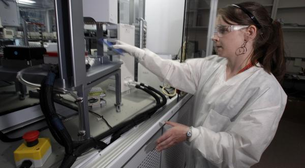 Cheryl Gleasner, a research technologist at the Los Alamos National Laboratory, works with a genome sequencing machine designed for disease surveillance. Since the SARS epidemic in 2003, advances in sequencing technologies have greatly speed up the ability to detect and track a new virus.