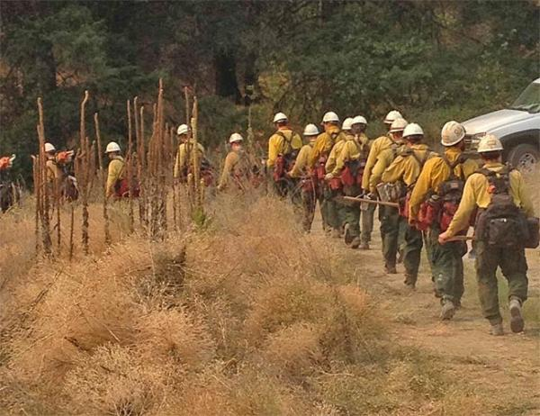 Crews are beginning to head home from the biggest wildfires in central Washington. Photo by by Michael Pennavaria via InciWeb