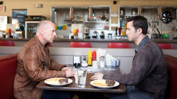 Bruce Willis and Joseph Gordon-Levitt play different versions of the same character in the time-travel thriller <em>Looper</em>.