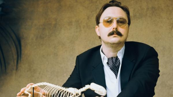 "<p><strong>""I could be wrong, you know</strong><strong>:""</strong> John Hodgman notes that while his book <em>That Is All</em> is intensely concerned with ""the coming global superpocalypse,"" it also contains much information about travel and sports and wine, and is ""not depressing."" </p>"