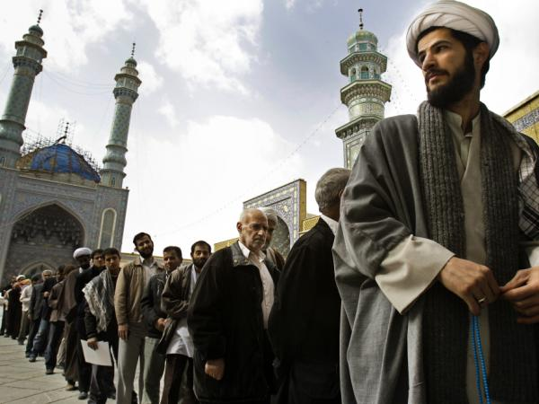 In Iranian parliamentary elections, candidates aligned with the country's Supreme Leader, Ayatollah Ali Khamenei, captured the vast major of the seats, according to media reports. Here, Iranians are shown standing in line to vote last Friday in the city of Qom, south of the capital Tehran.