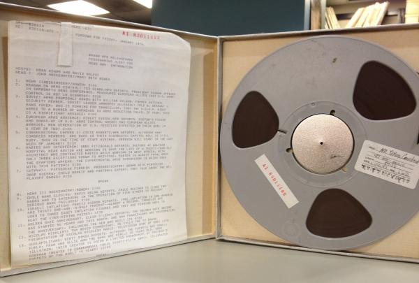 A reel-to-reel tape with the show rundown sheet (a brief description of each piece that aired on the program that day).