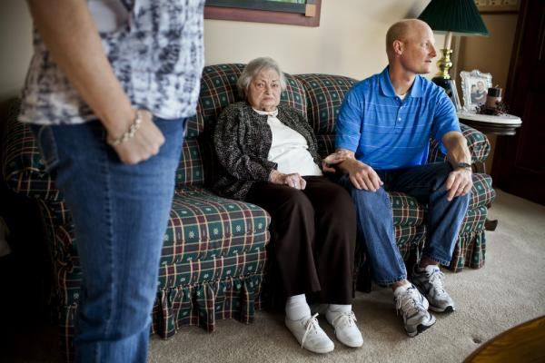"""David Martin sits with his grandmother AnnaBelle before leaving her at his sister Kelley's home. """"Hopefully they will learn how to take care of someone else, like me ... when I'm old,"""" says David of his children."""