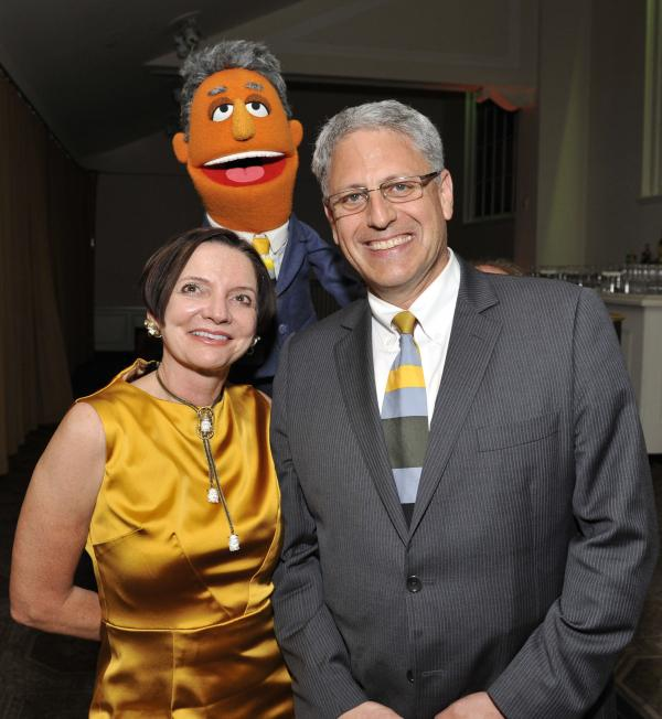 Jacki Lyden and Gary Knell pose with Gary Knell, the Muppet after the event.