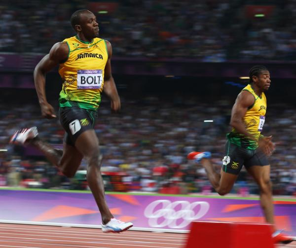 Usain Bolt of Jamaica crosses the finish line ahead of Yohan Blake of Jamaica to win gold during the Men's 200m Final.