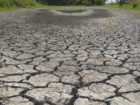 A YouTube user who goes by Katzcradul posted this image of a parched gulch on her drought-stricken land in Missouri on the site.