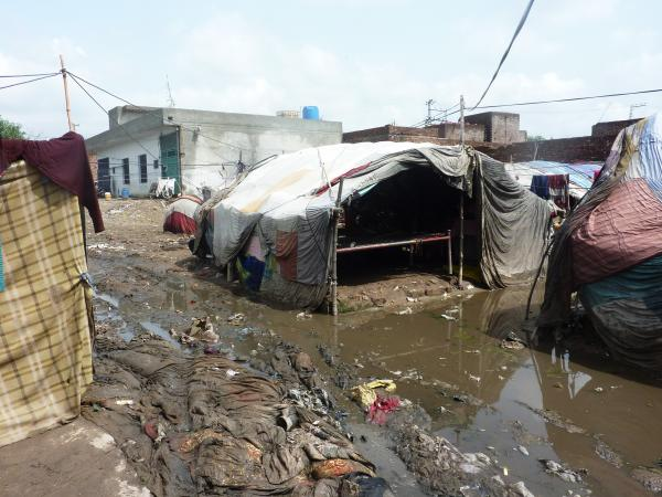 In an urban slum of Pakistan, the population is highly transient. People will raise a cloth tent one day, stay a little while and then move on.