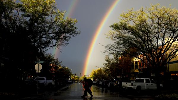 A rare thunderstorm produced hail, torrential rain and a double rainbow in downtown Fort Collins, Colo., last month.