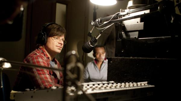 DJ Davis McAlary (Steve Zahn) interviews John Boutte about an unreleased recording of his.