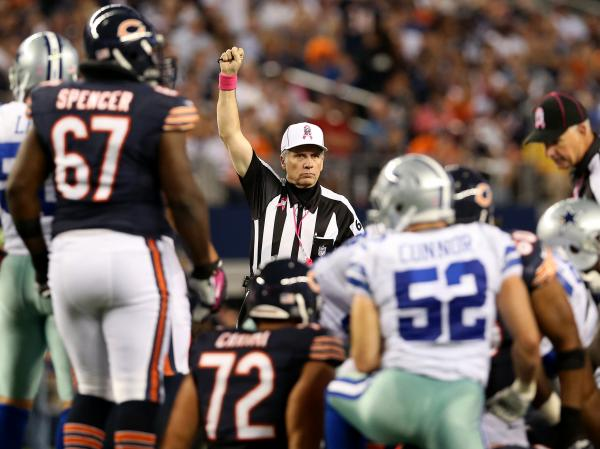 Referee Walt Anderson makes a call in the Chicago Bears game against the Dallas Cowboys Monday, ending the NFL's first full slate of games with its regular officials.